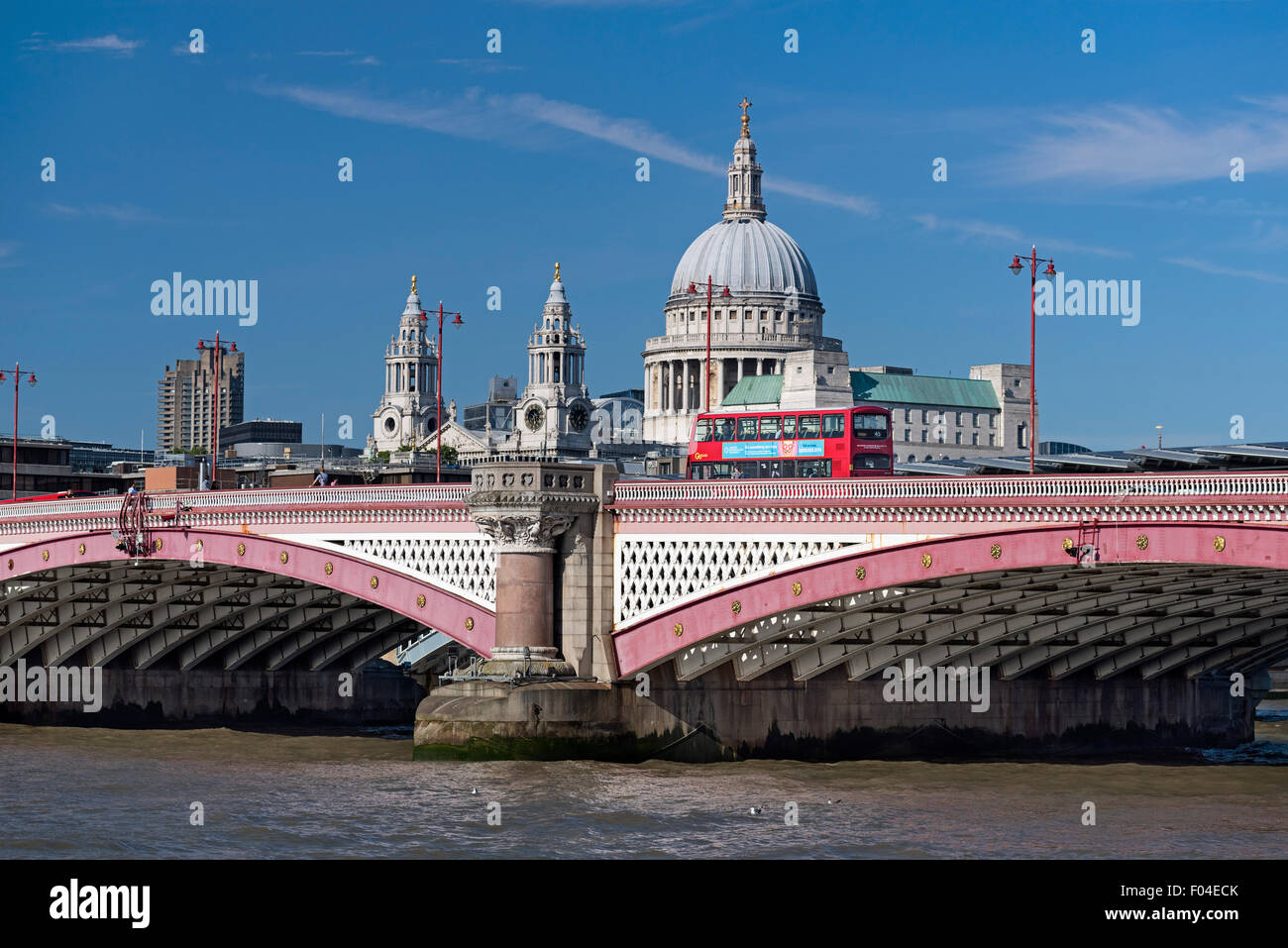 Blackfriars Bridge, St Paul's cathedral and red bus. London UK - Stock Image