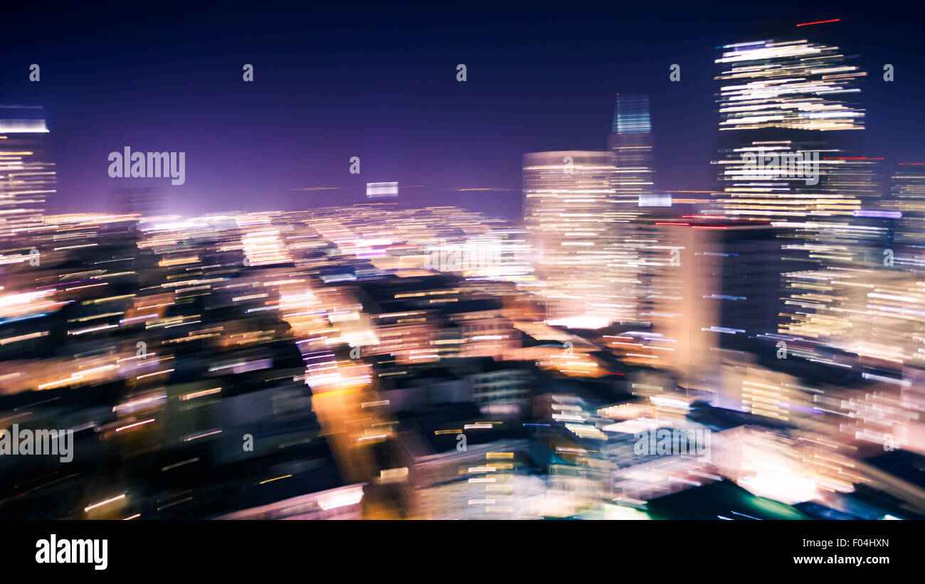 Panned motion blur of San Francisco skyline at night - Stock Image