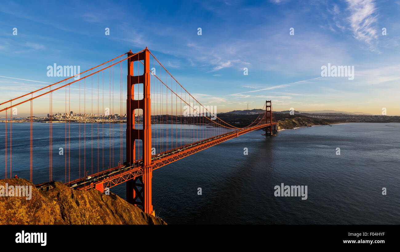 San Francisco Golden Gate Bridge and cityscape at sunset - Stock Image