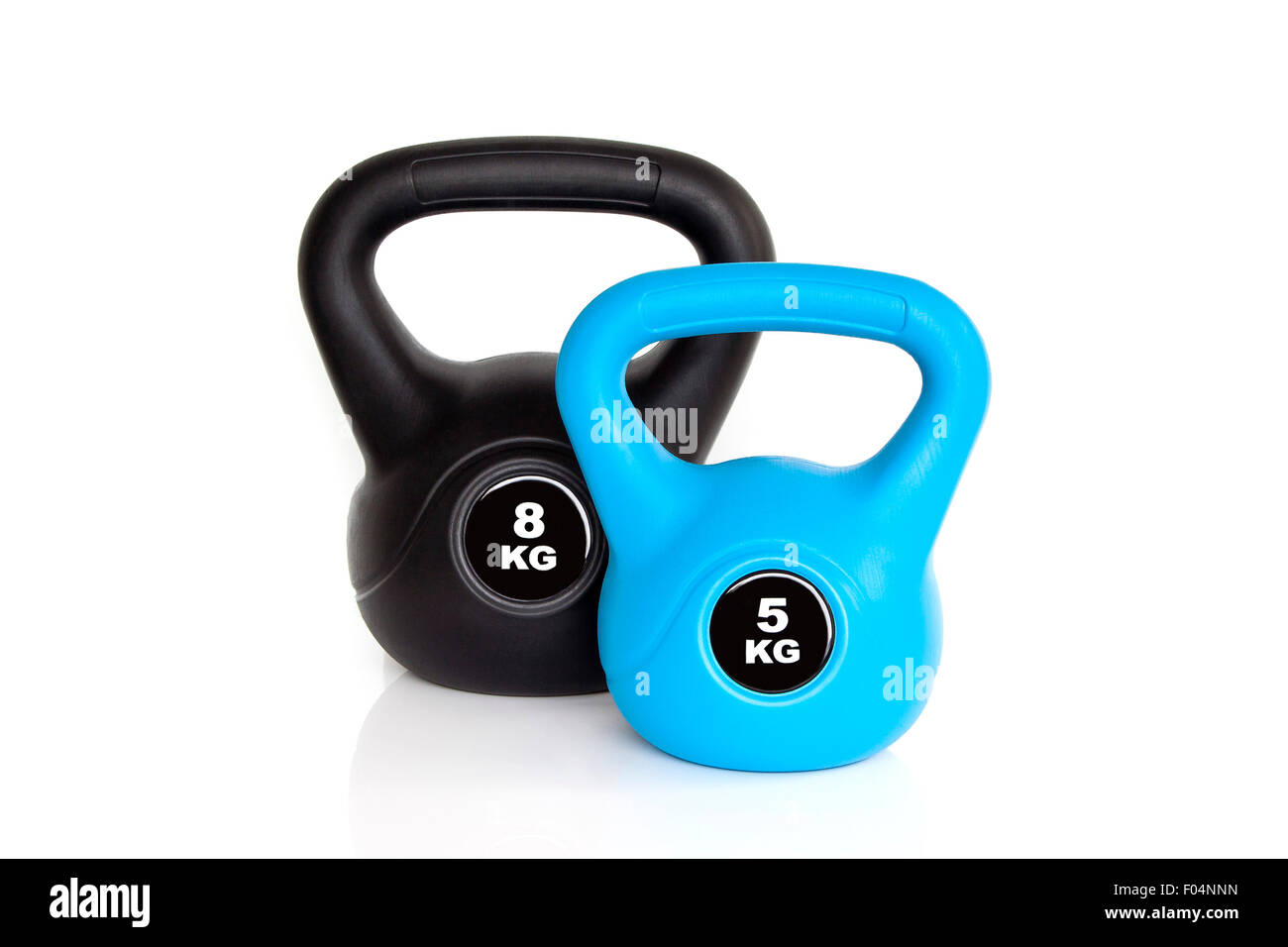 A pair of black 8 kg kettlebell and 5 kg blue kettlebell isolated on white background. Weights for a fitness training. - Stock Image