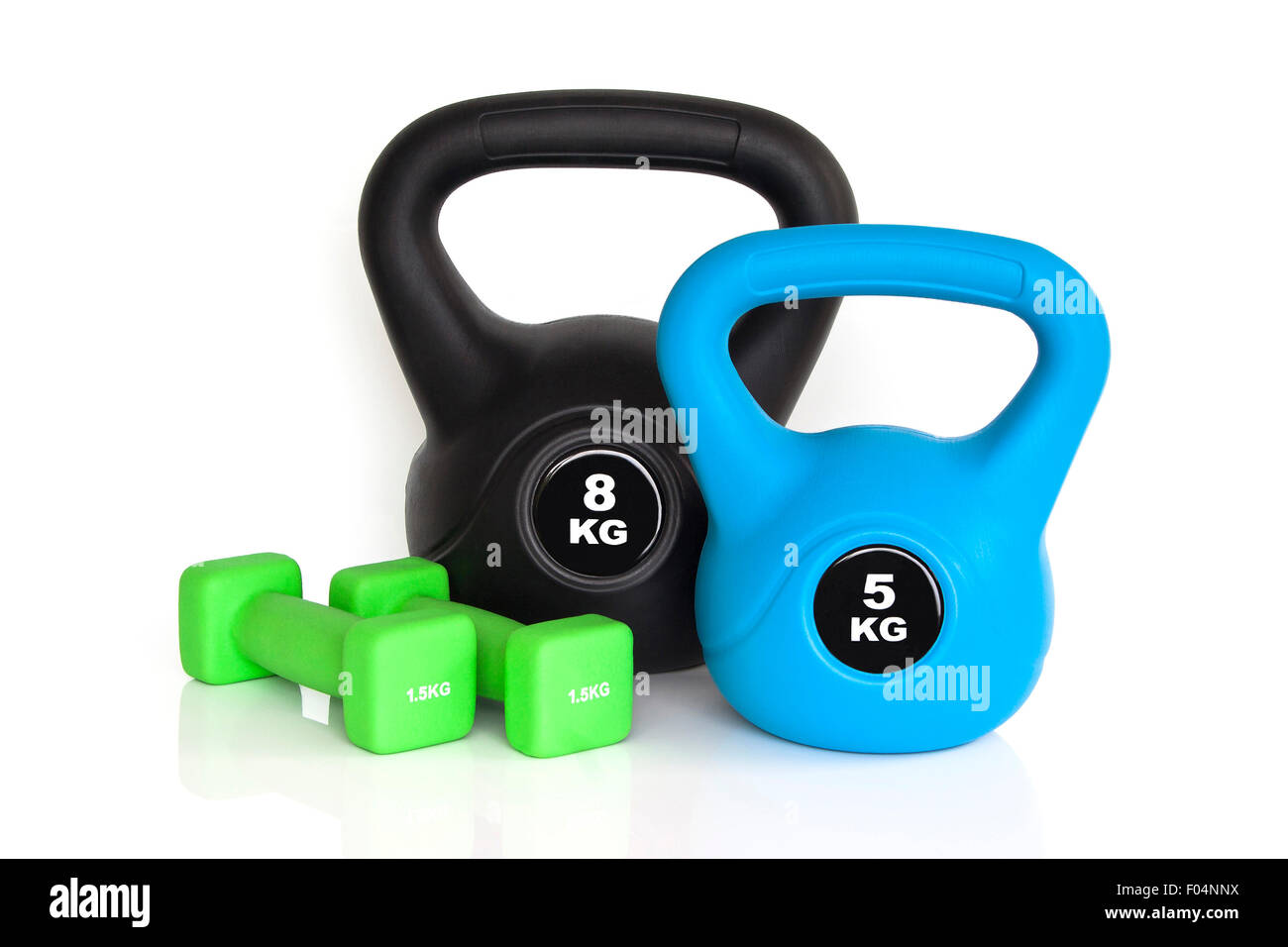 Dumbbells and kettlebells isolated on white background. Weights for a fitness training. - Stock Image