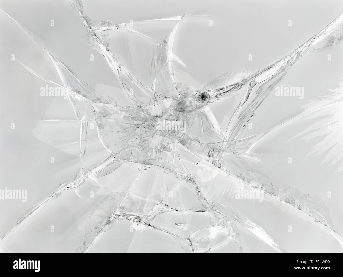 Gray background of cracked glass - Stock Image