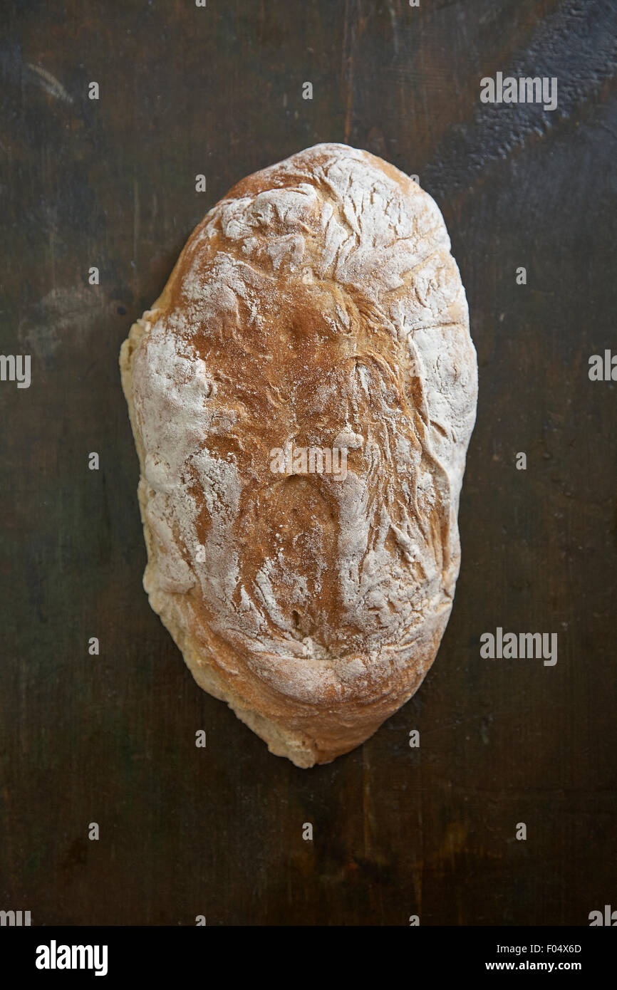 Artisan bread on a wooden board - Stock Image