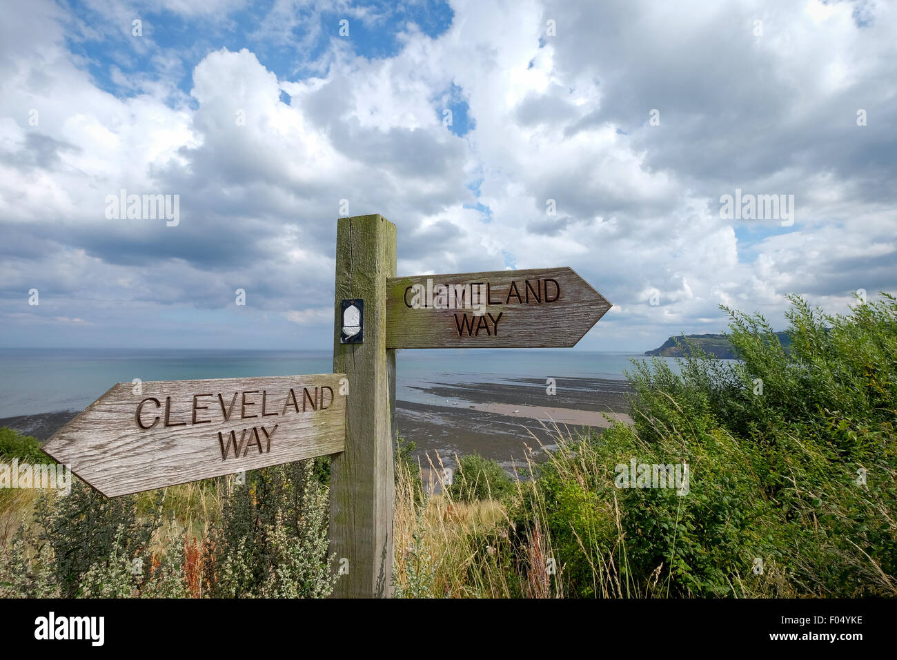 A signpost for the Cleveland Way long distance walk at Robin Hood's Bay in North Yorkshire - Stock Image