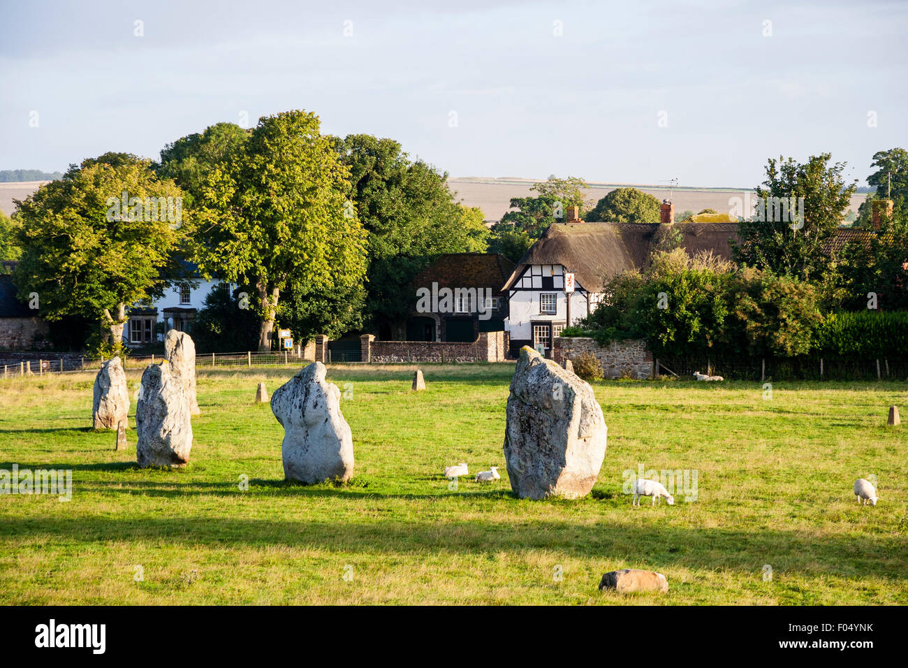 Avebury stone circle, Southern inner circle, curved row of stones, early morning, long shadows, clouds in sky - Stock Image