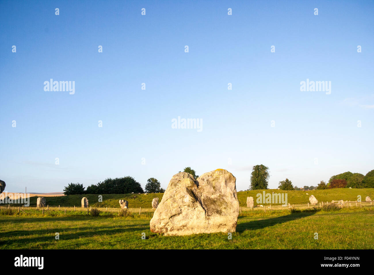 Avebury stone circle, Southern inner circle, long view of massive standing stone with large expense of blue sky - Stock Image