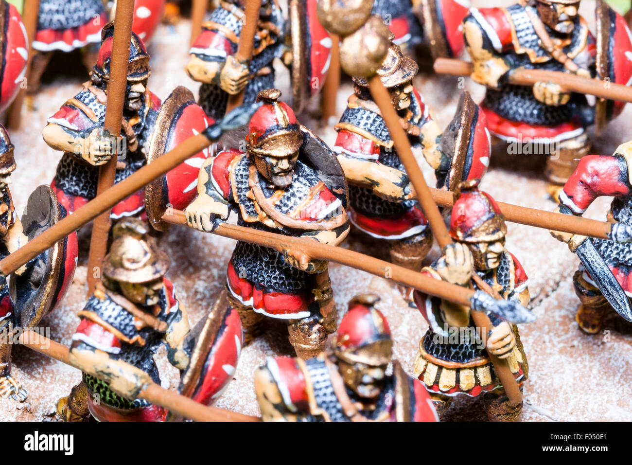 Close-up of metal painted model figures. Mass of Carthaginian foot soldiers advancing on table top battlefield - Stock Image