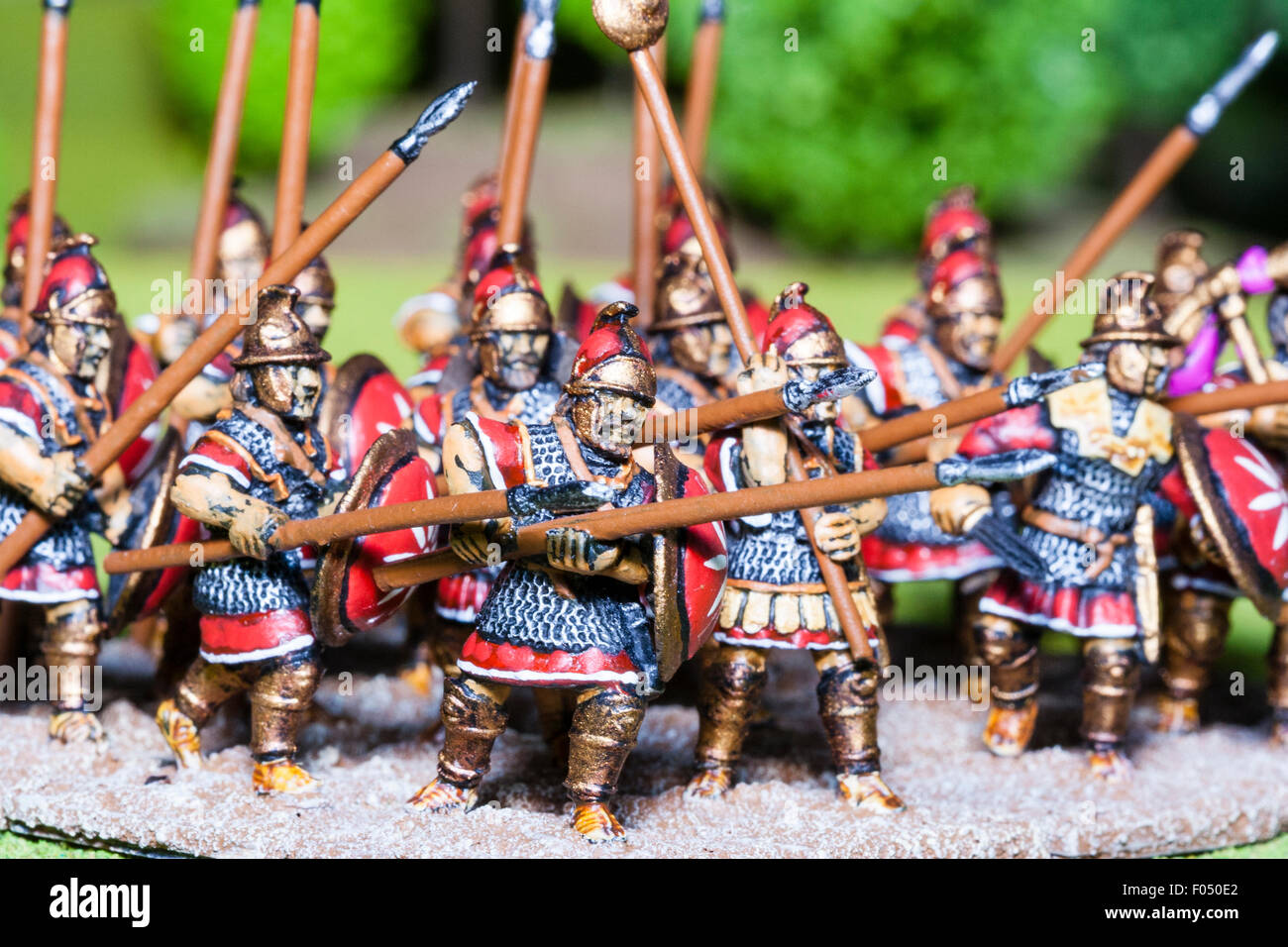 Close-up of metal painted model figures. Mass of Carthaginian foot soldiers advancing on table top battlefield Stock Photo