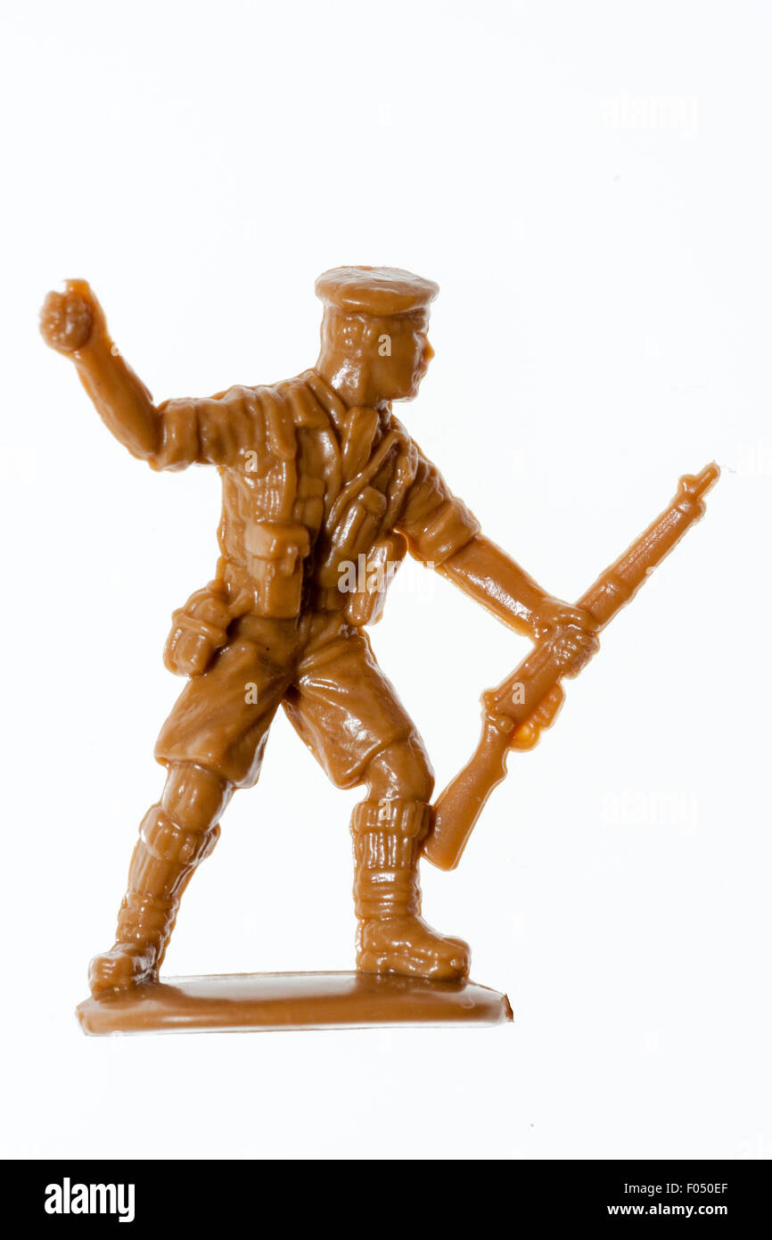Matchbox HO/OO plastic model soldier figure. World War Two, 8th army. Plain white background. Man throwing a grenade - Stock Image