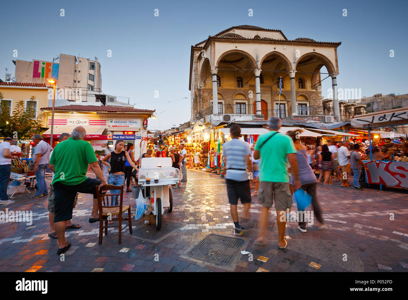Sweets sellers and tourists in front of the mosque in Monastiraki square - Stock Image