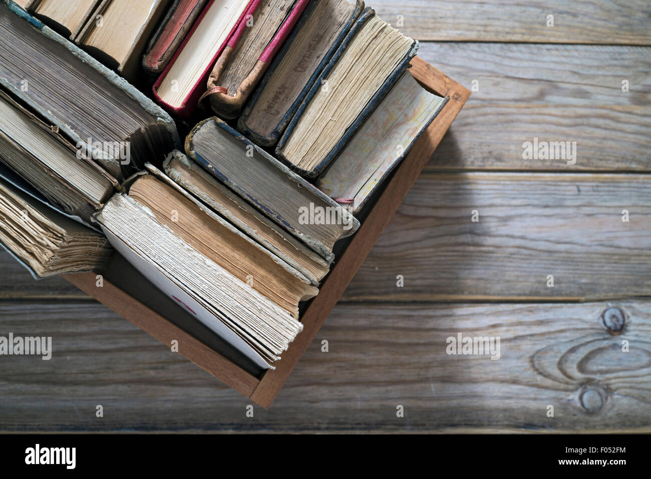 Old books in the wooden box - Stock Image