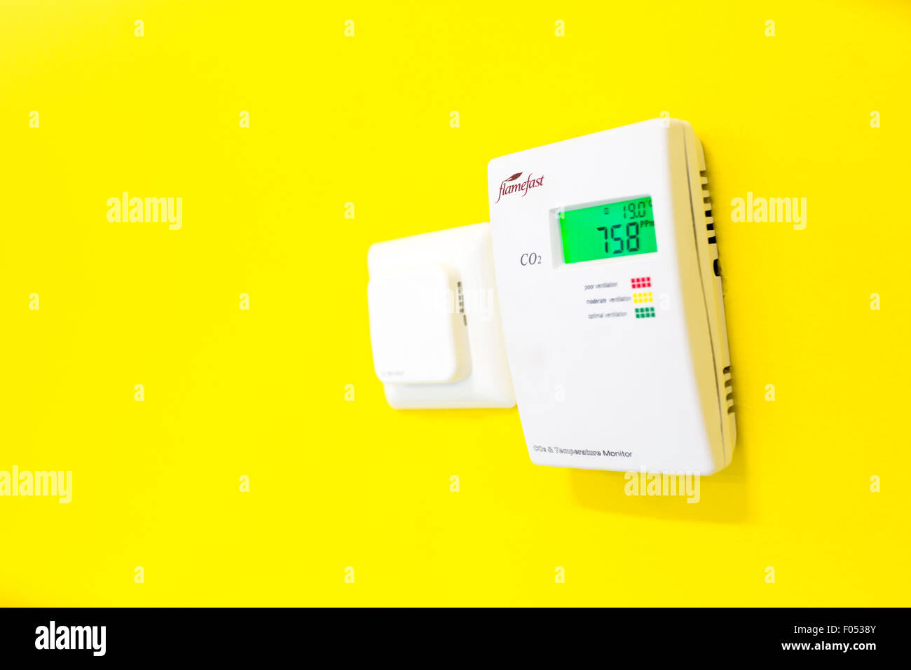 Flamefast temperature monitor on a wall - Stock Image