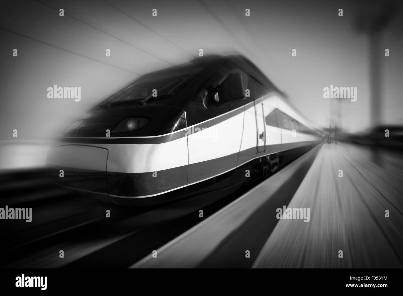 High-speed modern intercity train with motion blur, abstract. Monochromatic - Stock Image