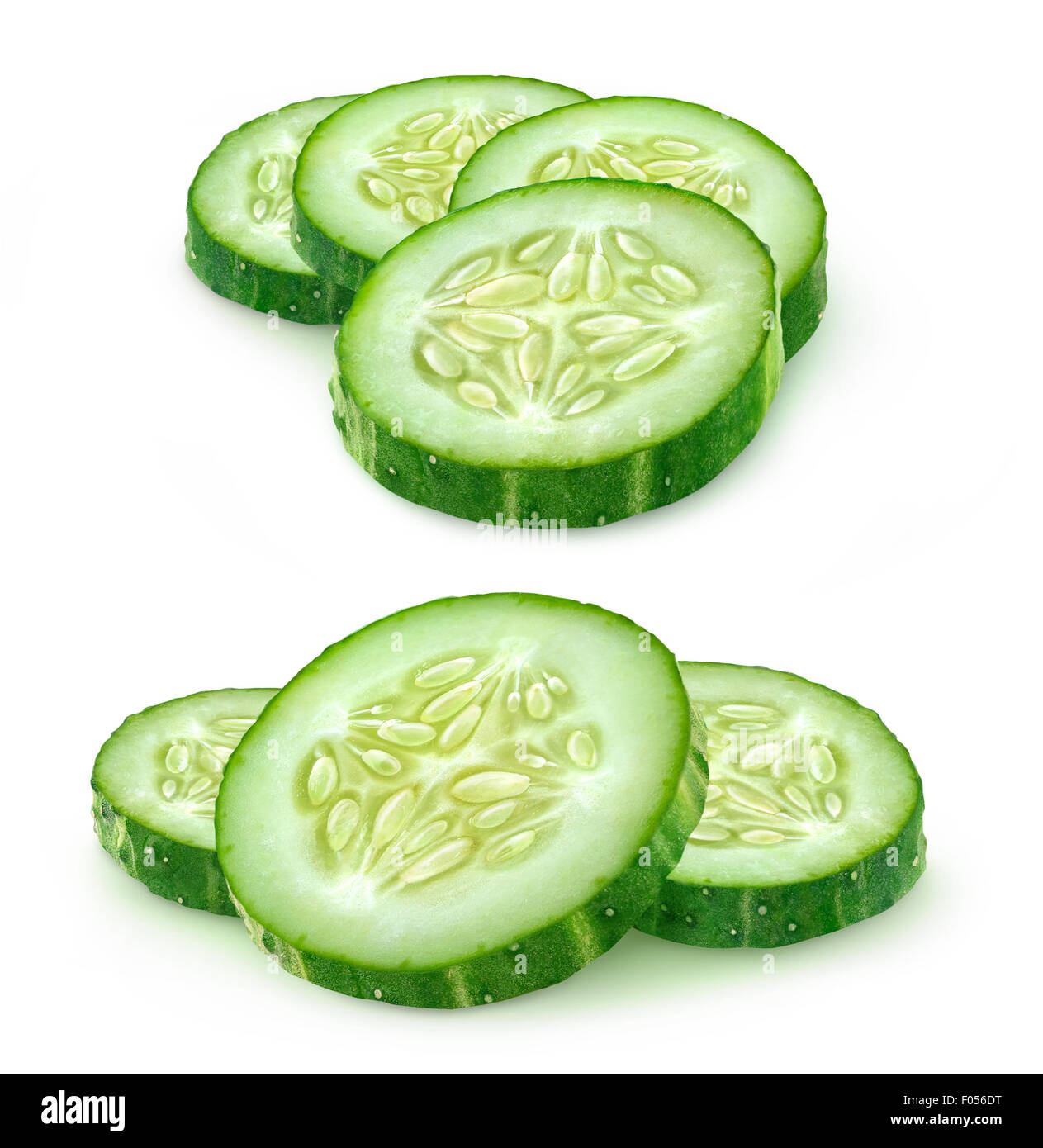 Slices of cucumber over white background, with clipping path - Stock Image