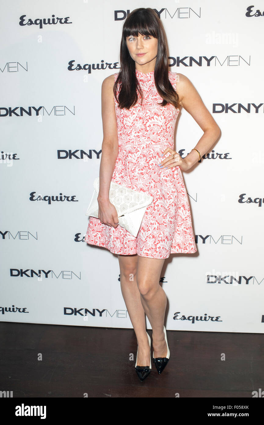 Model Lilah Parsons standing at step and repeat board at DKNY event. - Stock Image