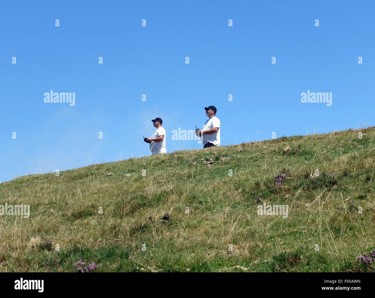 Two men controlling their model aircraft in the French Pyrenees, France - Stock Image