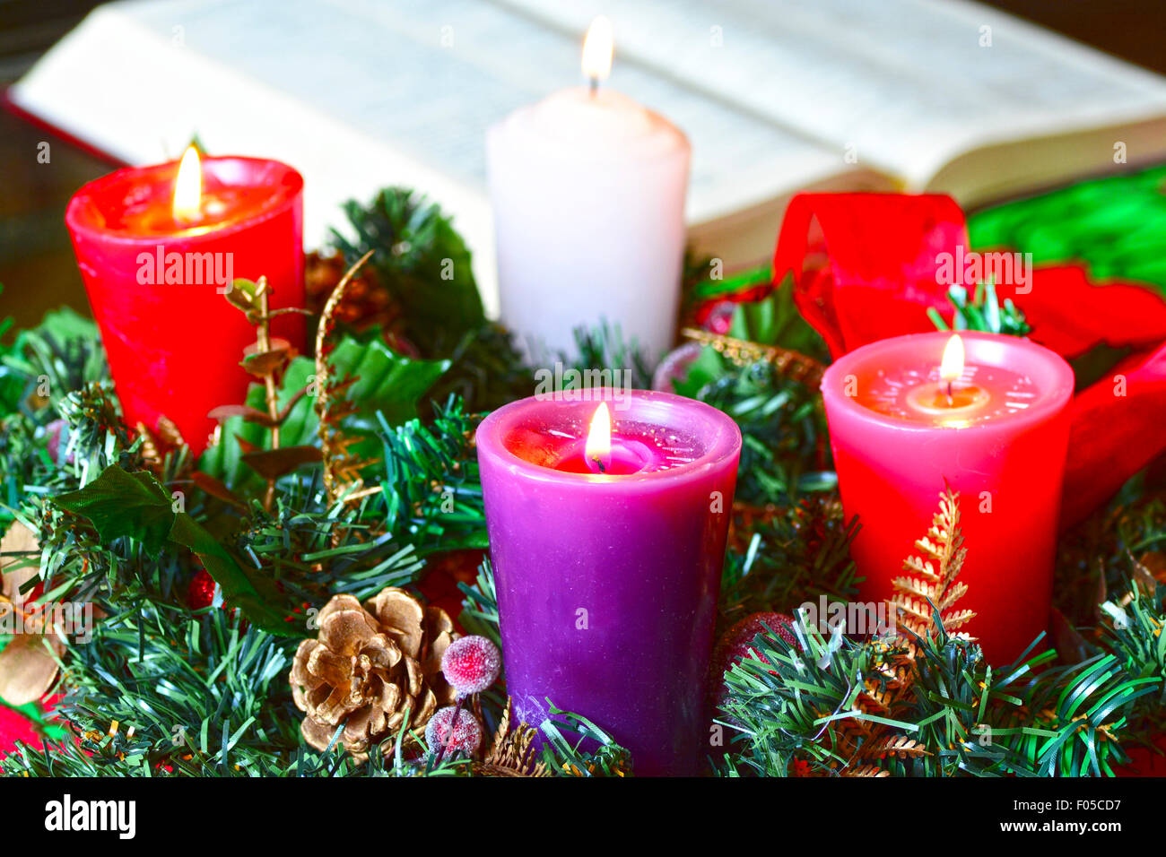 Advent wreath, or Advent crown, is a Christian tradition that symbolizes the passage of the four weeks of Advent - Stock Image