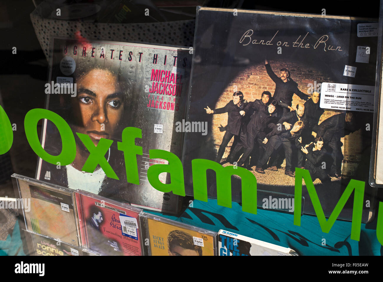 Vinyl records and CD's for sale in the window of an Oxfam charity shop in Edinburgh. Stock Photo
