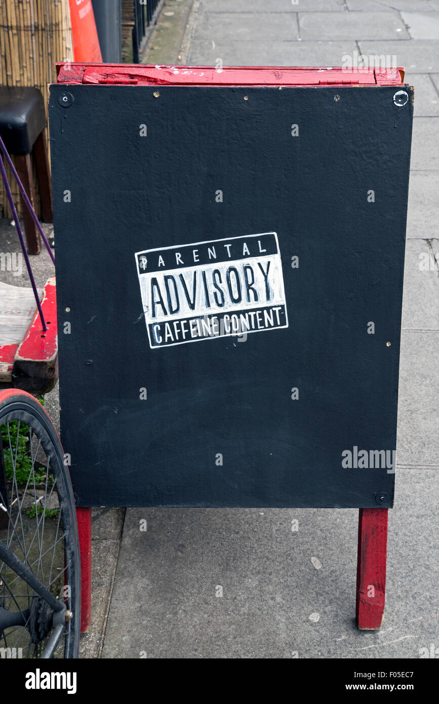 A-board advert outside 'Artisan Roast' in Broughton Street, Edinburgh featuring a Parental Advisory - Caffeine - Stock Image
