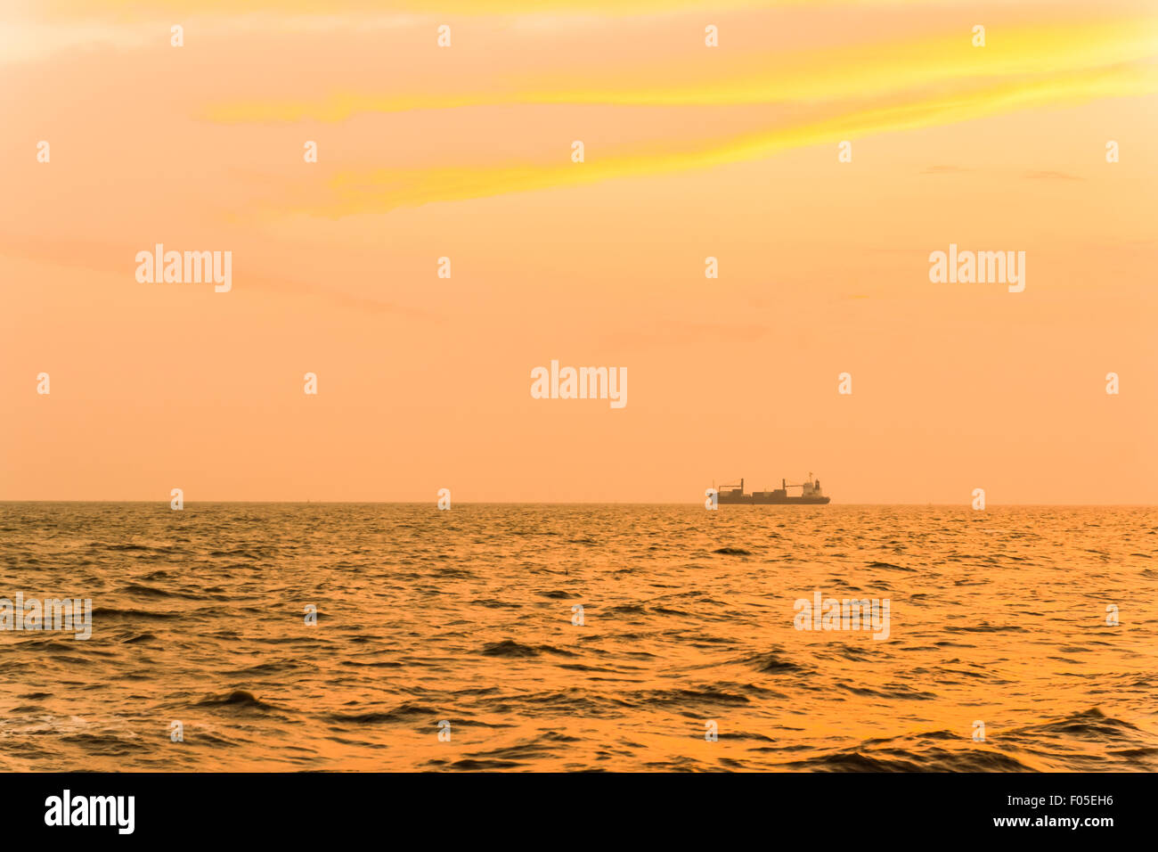General cargo ship in the evening - Stock Image