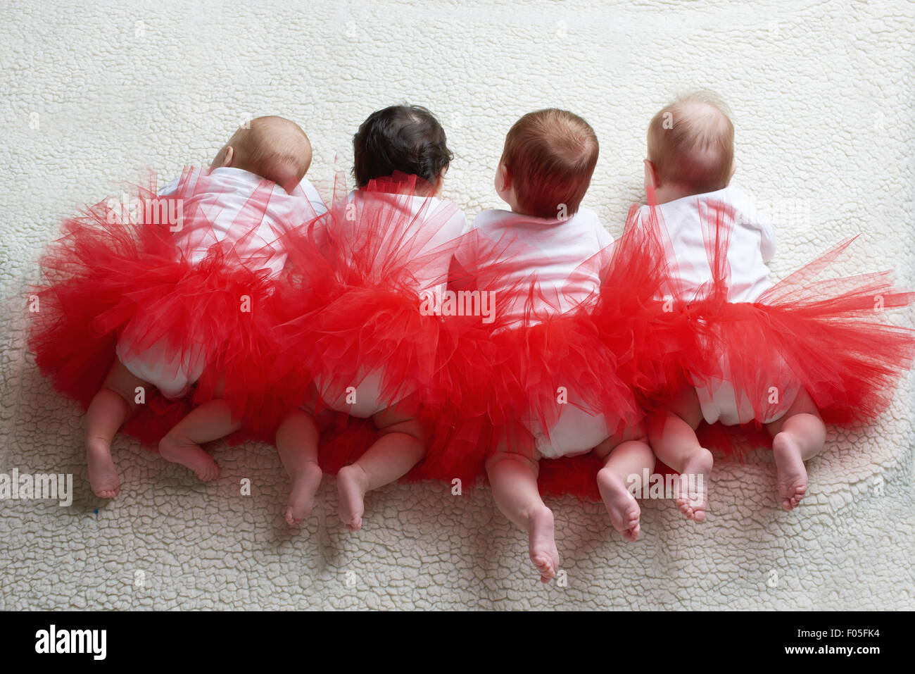 Babes in skirts ballerinas rear view - Stock Image