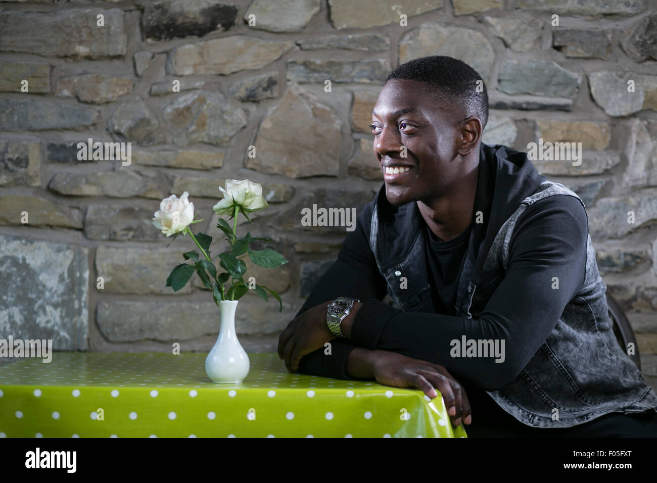 Portrait of footballer Marvin Sordell in a tea room. - Stock Image