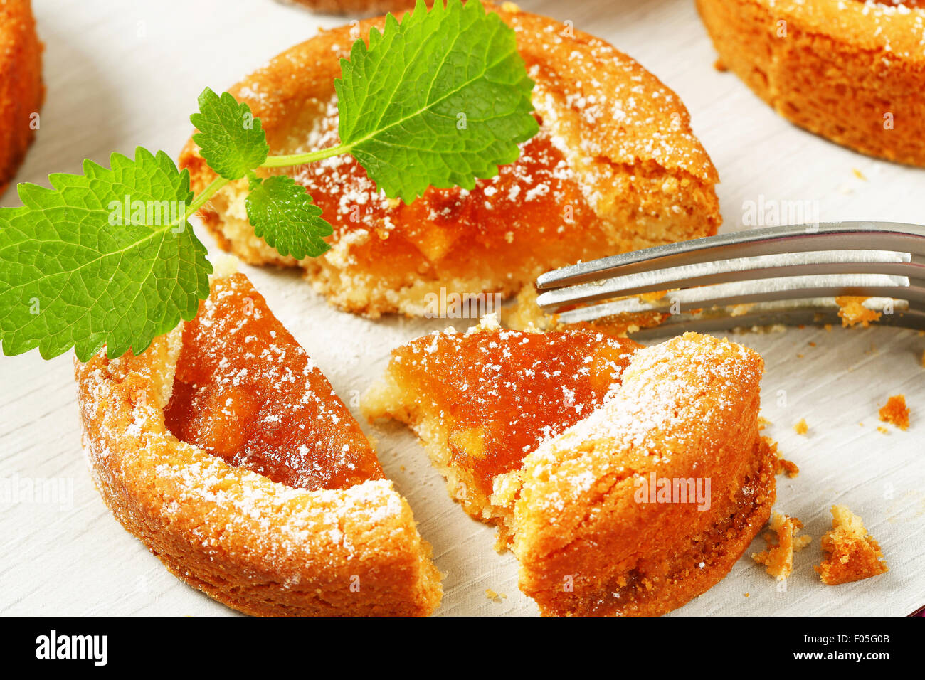 Small round cakes filled with apple puree - Stock Image
