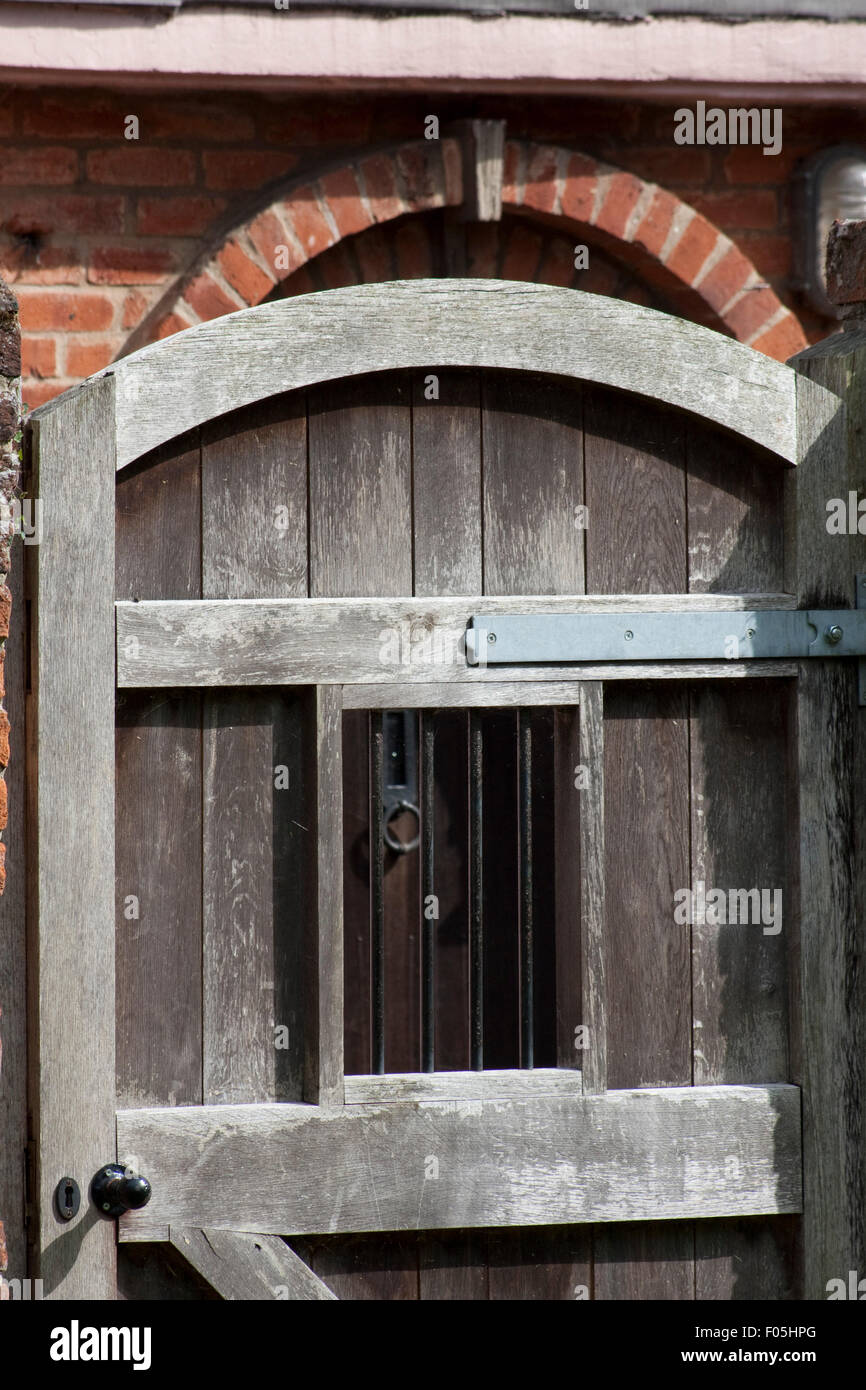 A Wooden Gatedoor With A Barred Judas Window Stock Photo 86175560