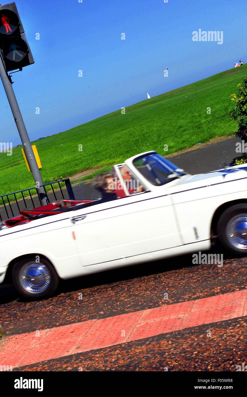 Triumph Herald soft top car / Classic convertible car - Stock Image