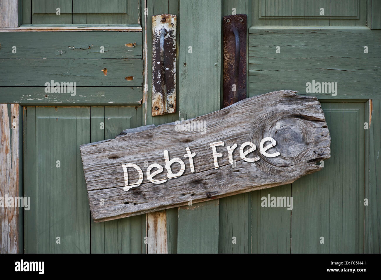 I am debt free sign on green doors. - Stock Image