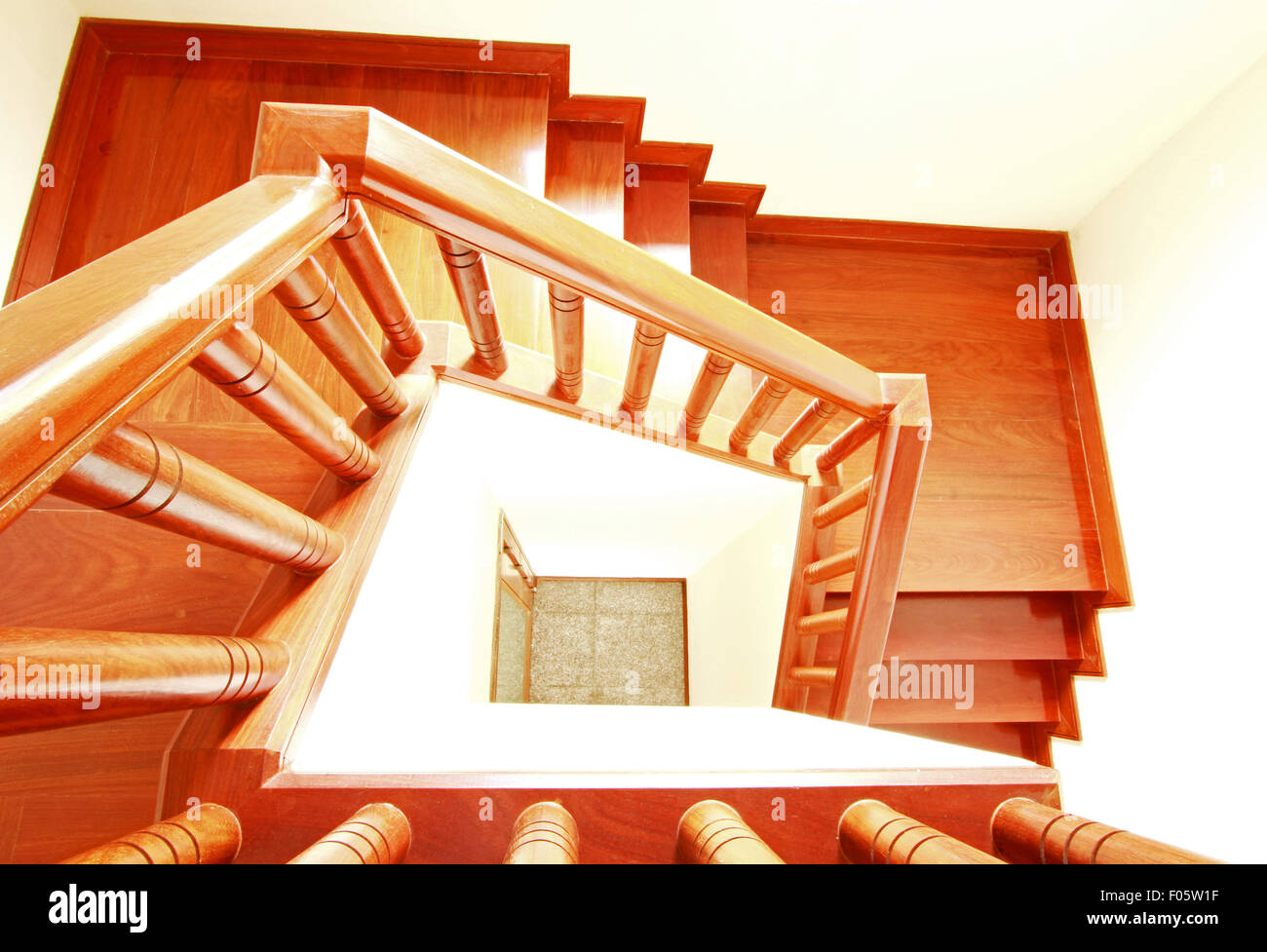 Wooden stairs and handrail - Stock Image