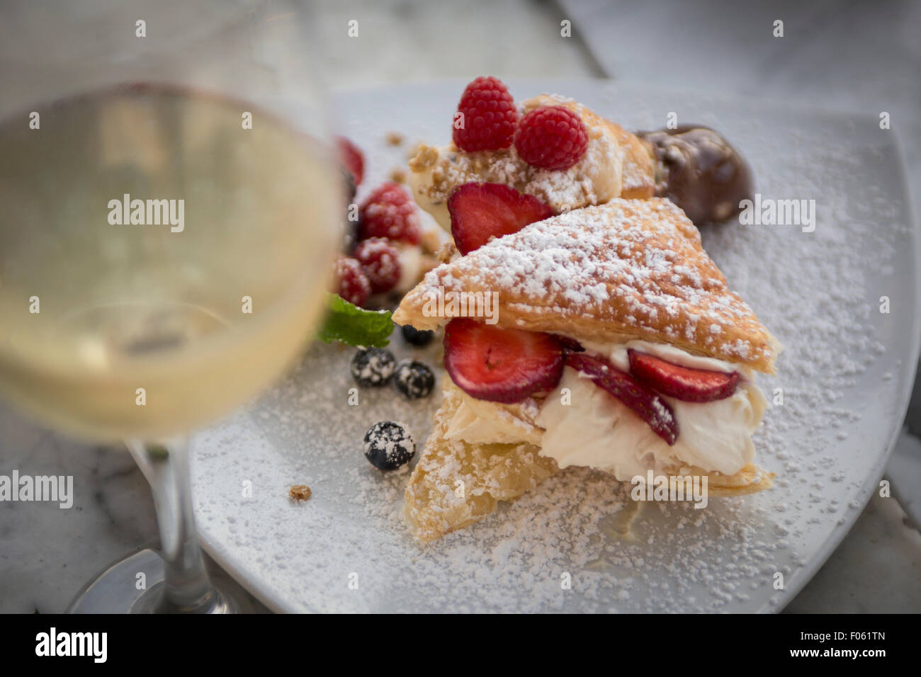 Italian Desserts Garnished with Fruit and White Wine - Stock Image