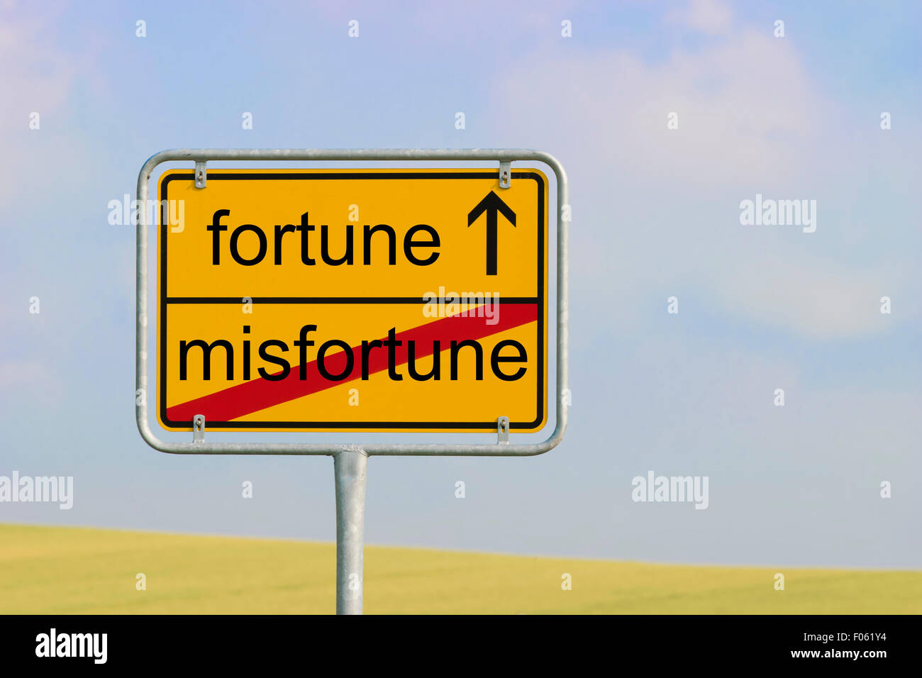 Yellow town sign with text 'misfortune fortune' - Stock Image