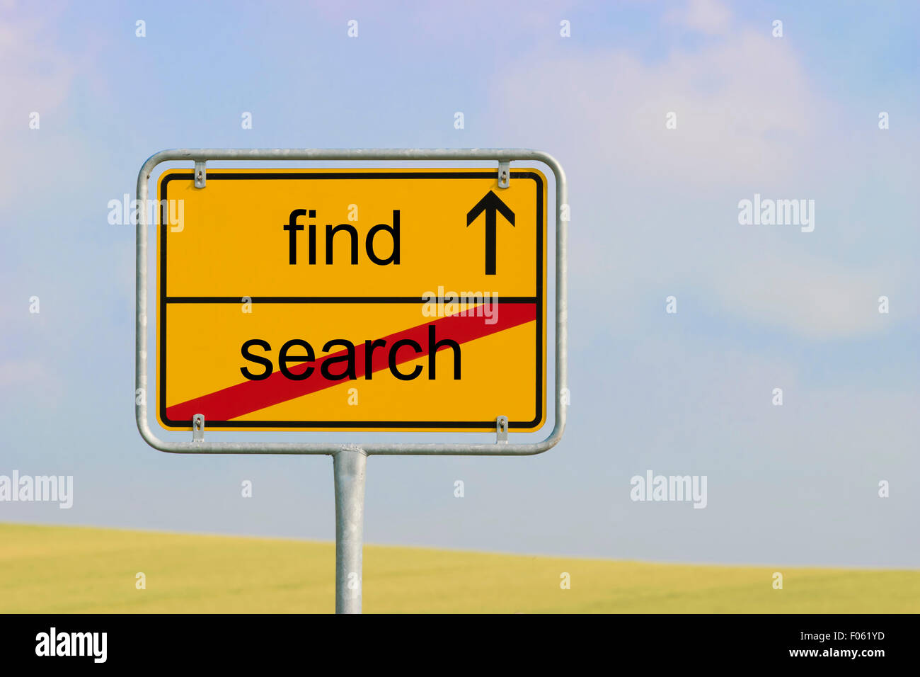 Yellow town sign with text 'find search' - Stock Image