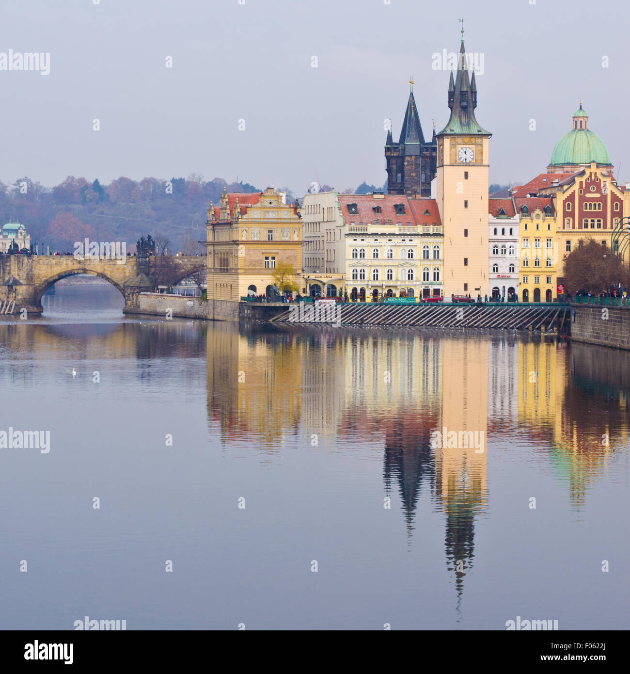 Charles Bridge, Karlovy Lazne and Lavka clock tower in Prague - Stock Image