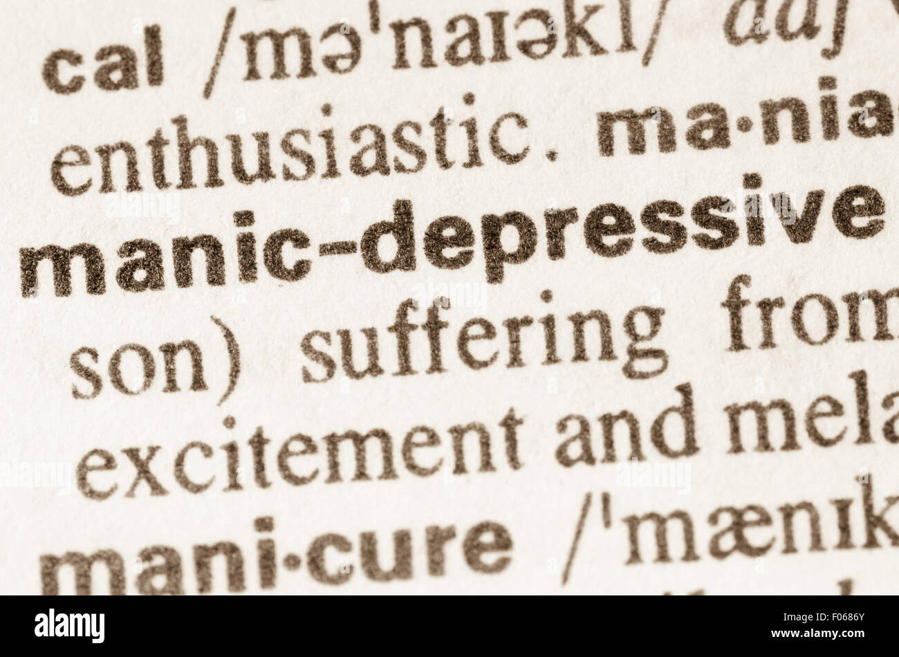 definition of word manic-depressive in dictionary stock photo