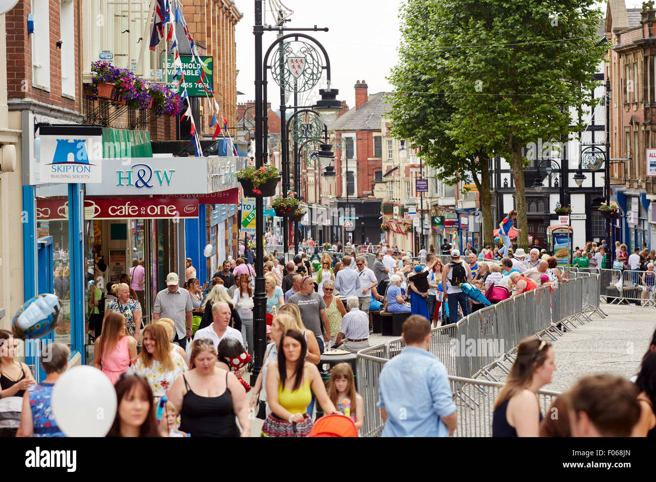 Warrington town centre in Cheshire   Shops shopping shopper store retail supermarket retailer retailers traders - Stock Image