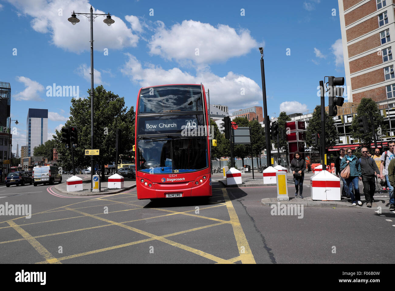 Red double decker 205 London bus on Old Street heading to Bow Church crossing a box junction in East London  UK - Stock Image