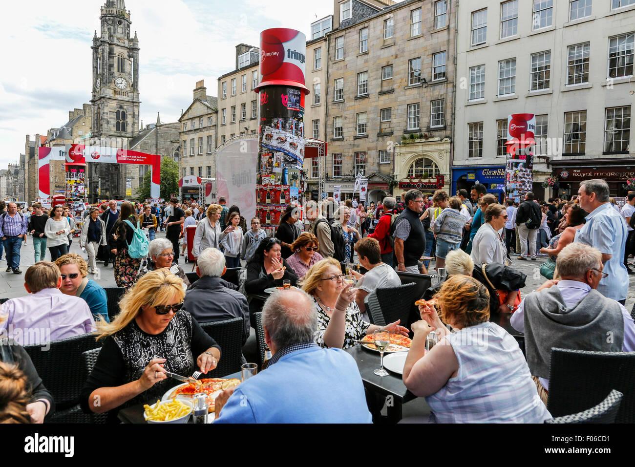 Edinburgh, Scotland, UK. 8th Aug, 2015. On the first Saturday of the Edinburgh Fringe, visitors to Edinburgh were - Stock Image