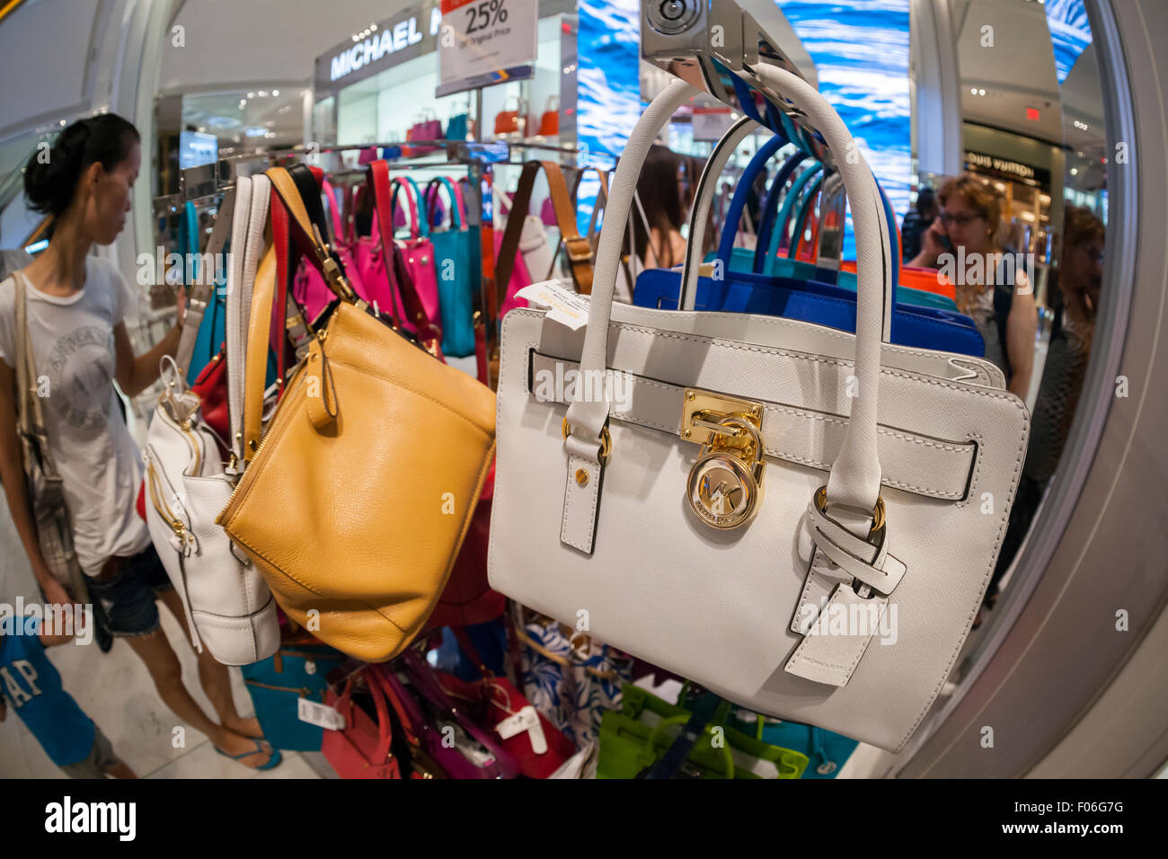 4546c879f545 Handbags on display at the Michael Kors boutique within Macy s in New York  on Tuesday