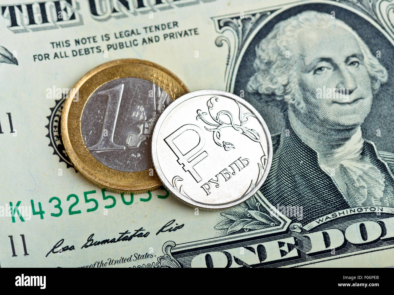 Russian rubles coin, euro and dollars banknotes close up - Stock Image