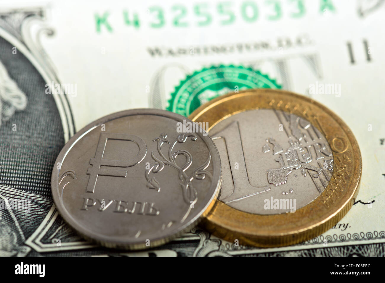 coin one ruble and euro against US dollar background - Stock Image