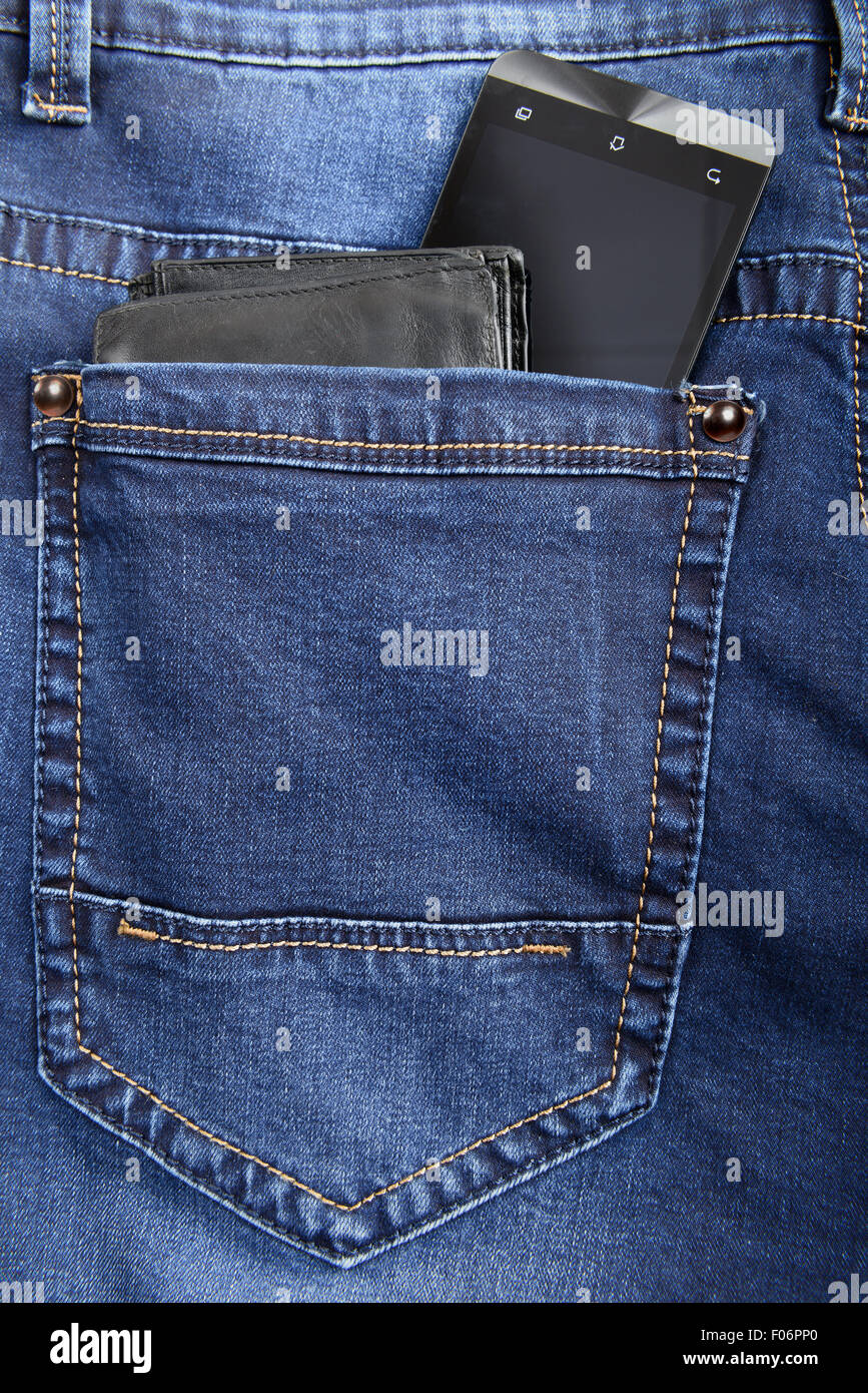 Blue jeans with wallet and smart phone in pocket - Stock Image