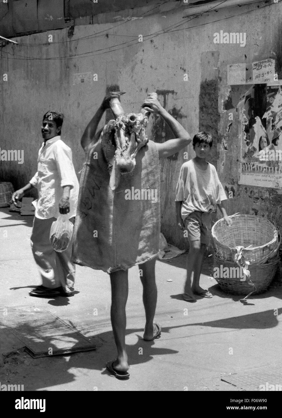 man carrying meat to market mumbai india brian mcguire - Stock Image
