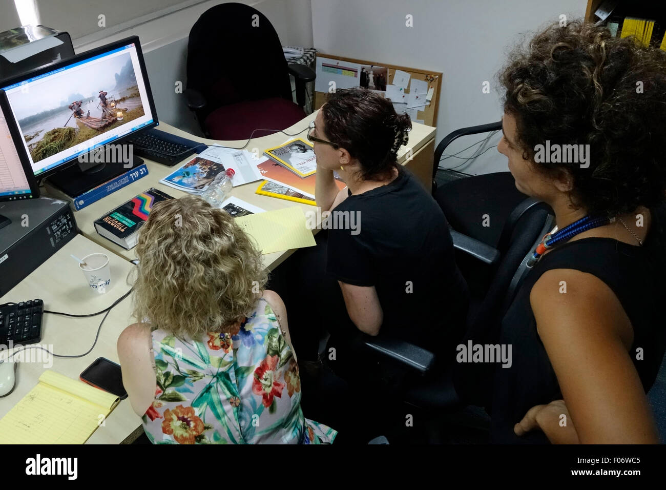 The editorial team of the National Geographic Magazine Israel edition at work. Tel Aviv Israel - Stock Image