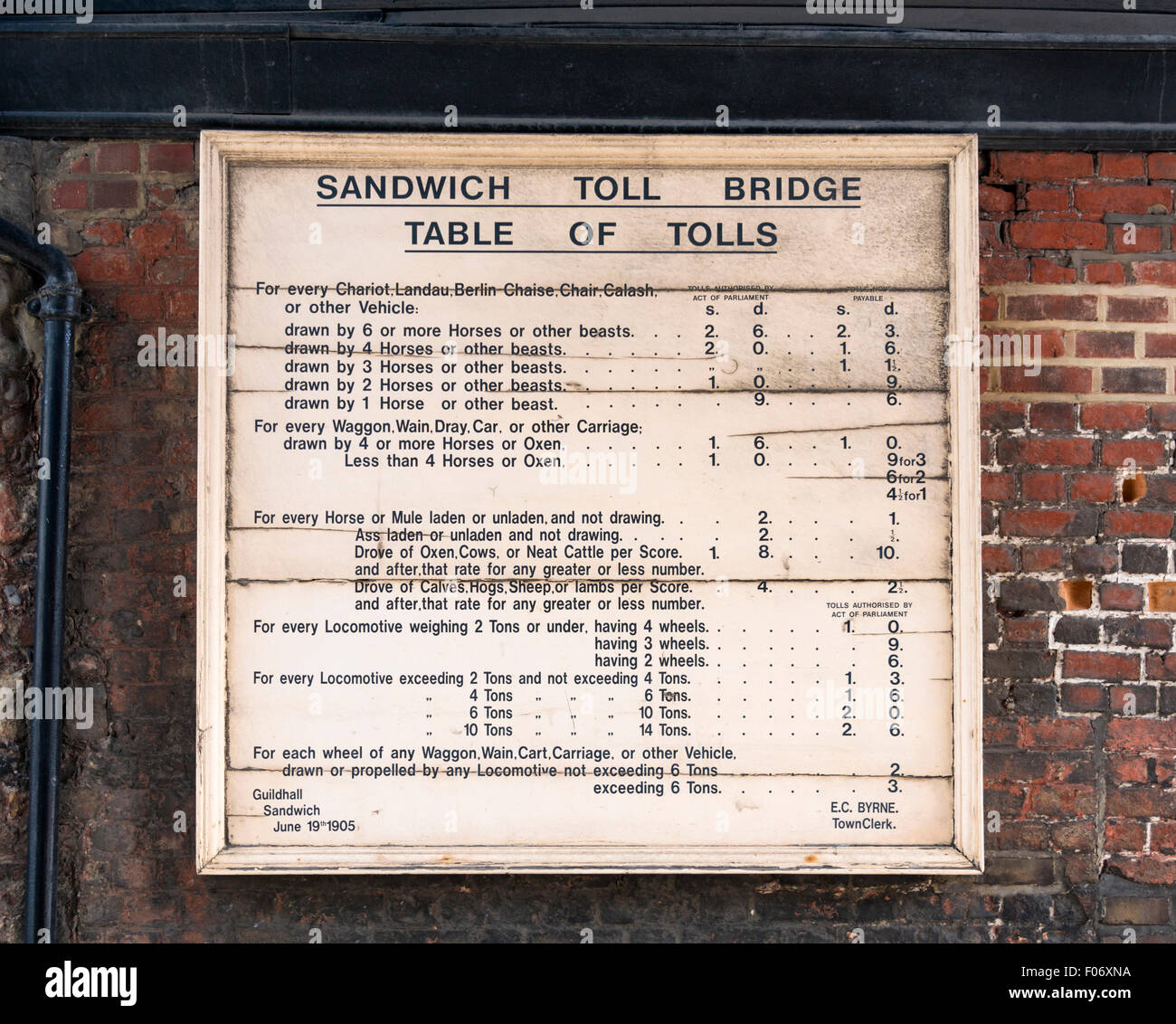 Sandwich toll bridge table of tolls from 1905 on the barbican over the river Stour Stock Photo