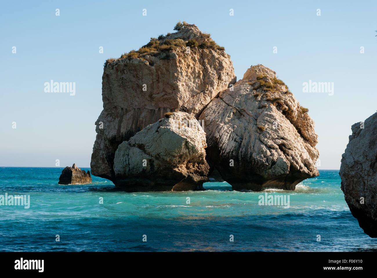 Famous touristic landmark Aphrodite's rock and empty pebble beach Petra tou Romiou at summer. Cyprus Stock Photo