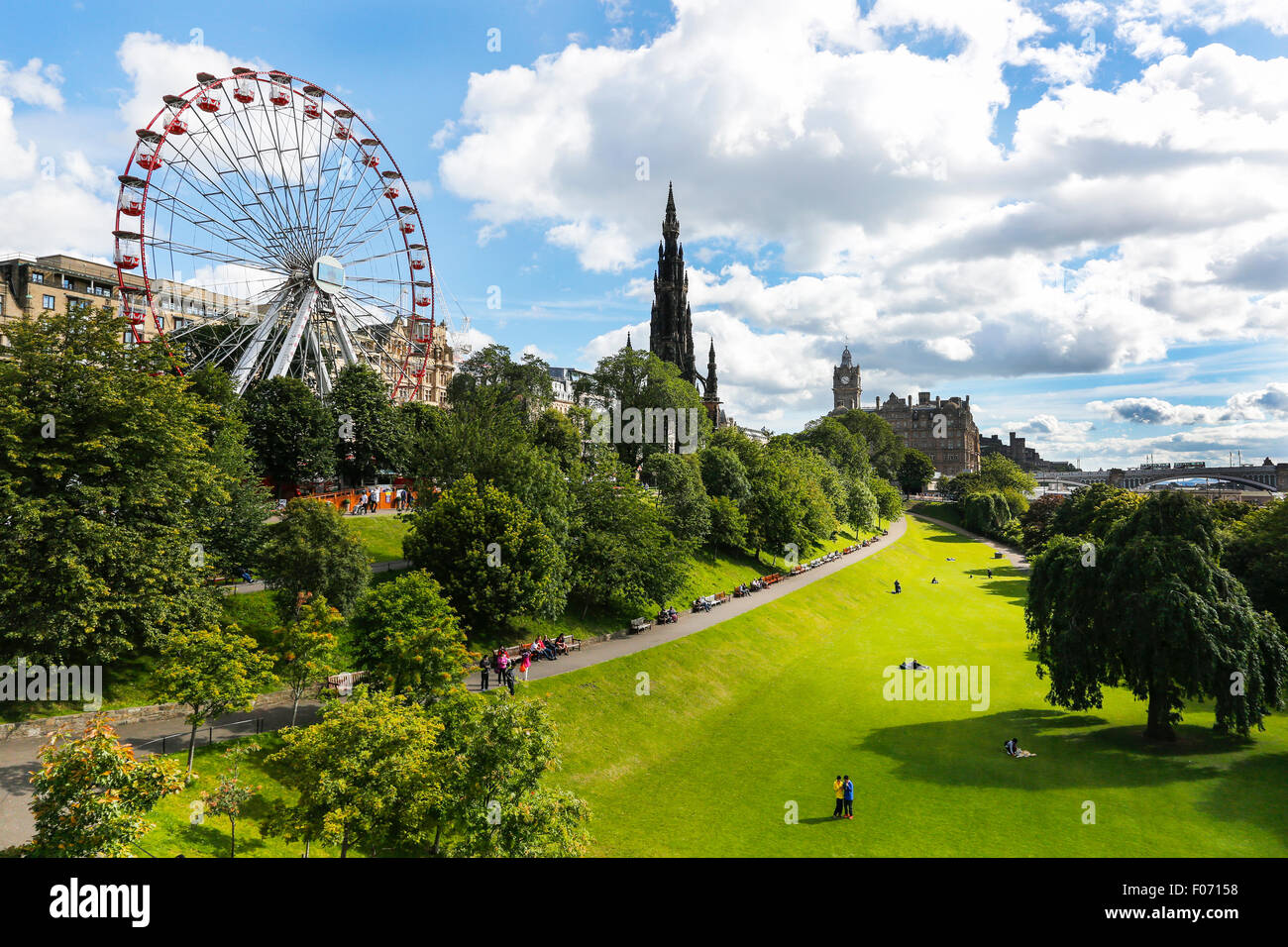 Princes Street Gardens, Edinburgh with a view to Scott Monument and the Princes Street Ferris wheel. Scotland, UK - Stock Image