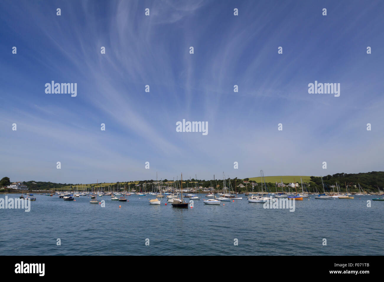 Small boats moored under a clear blue sky in Falmouth harbour, Falmouth, Cornwall Stock Photo