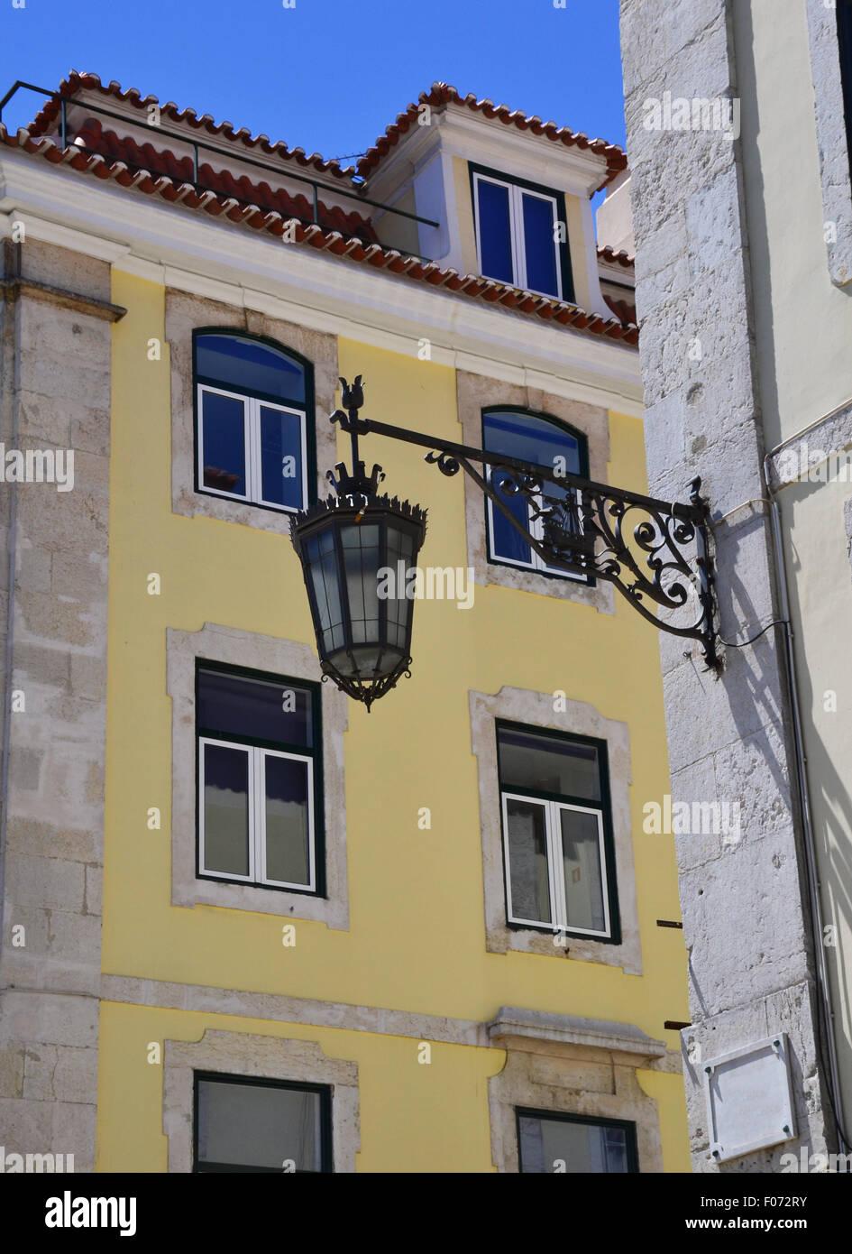 Old iron street lantern on a wall - Stock Image